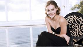 Willa Holland Smiling Sitting Pose In Black Long Dress